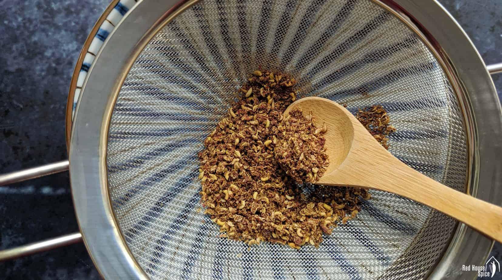 Crushed Sichuan pepper in a sieve