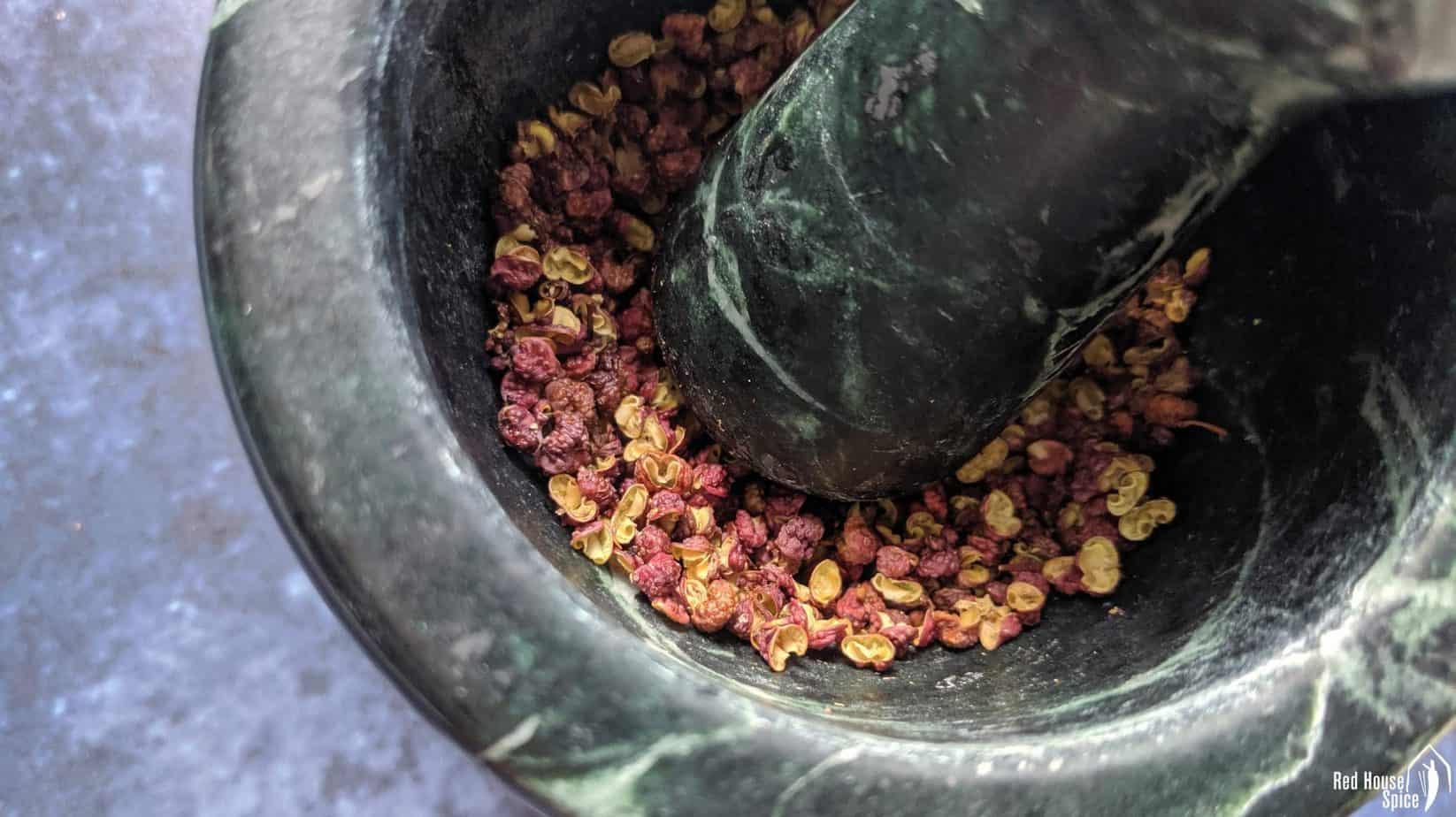 Roasted Sichuan pepper in a mortar