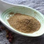 Ground Sichuan pepper in a spoon.