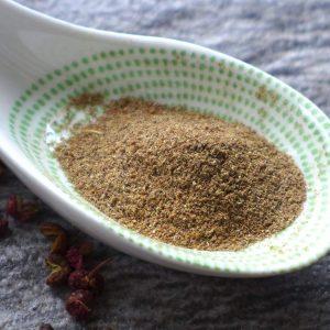 Ground Sichuan pepper in a spoon.