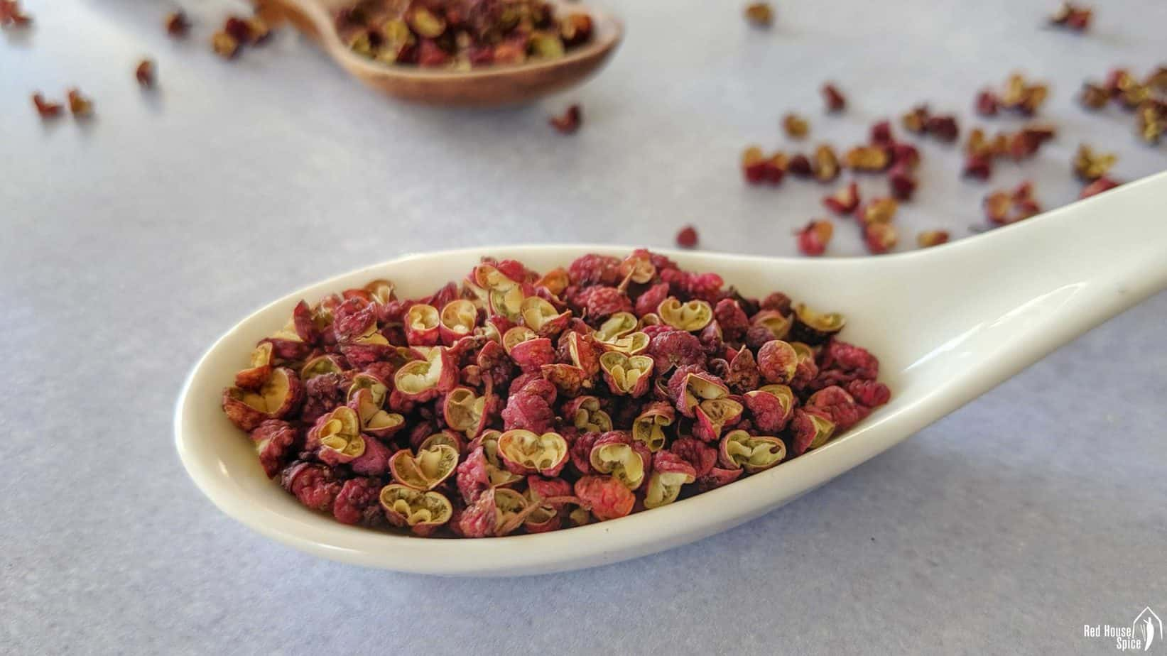 Whole Sichuan pepper in a spoon