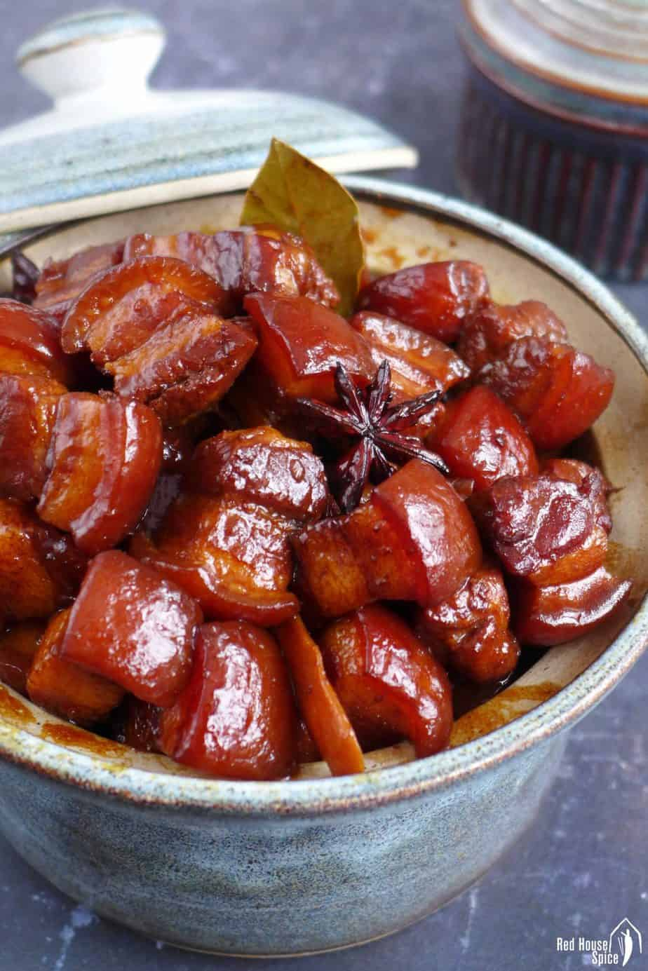 Chinese red braised pork belly in a bowl