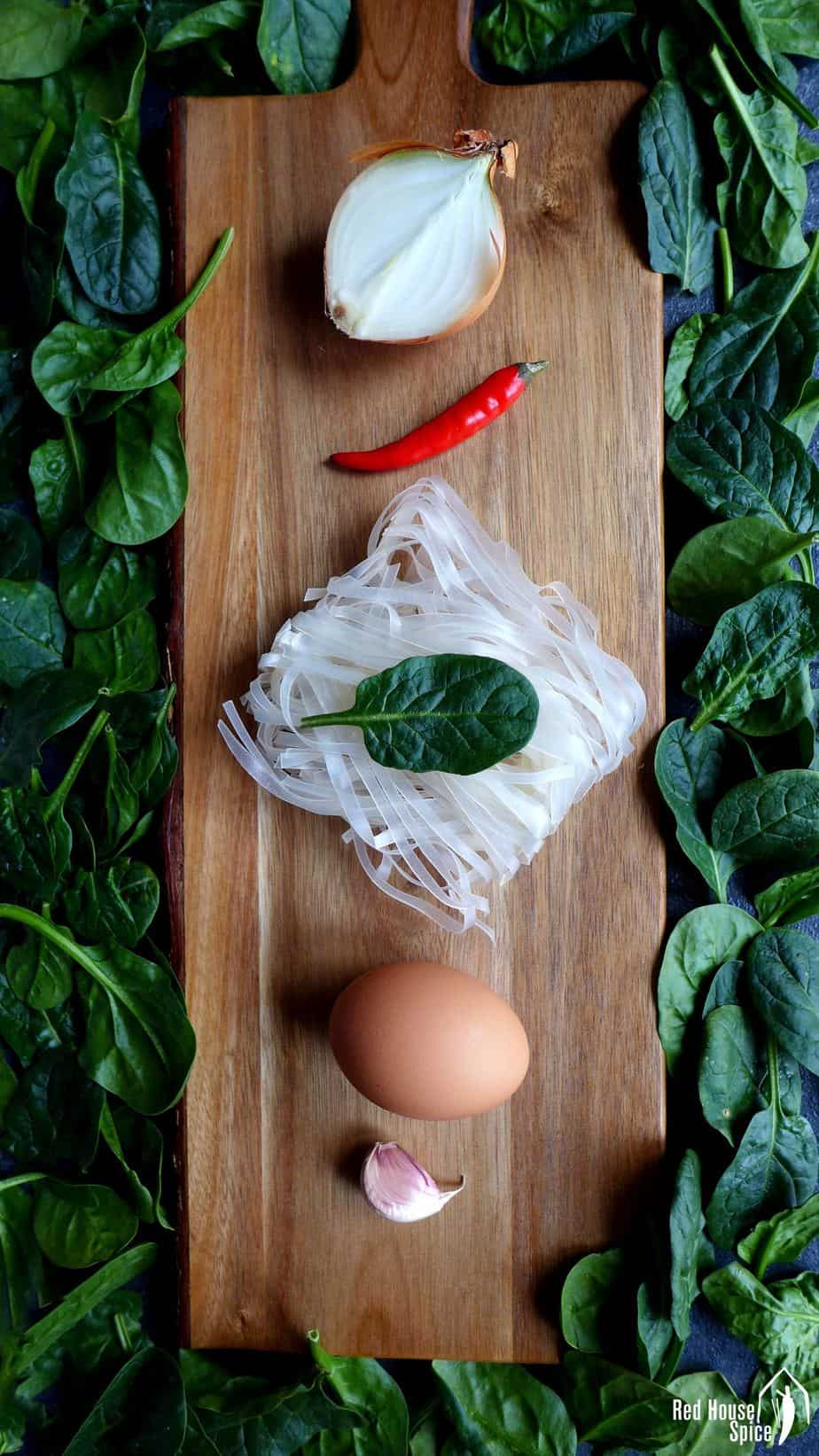 onion, chilli, rice noodles, egg, garlic and spinach
