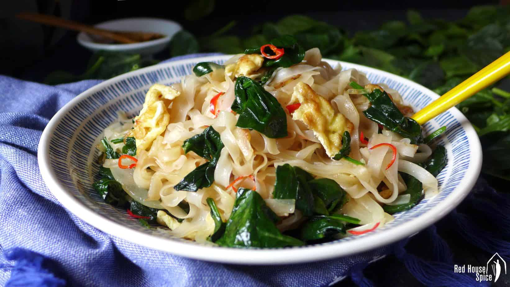 fried rice noodles with egg & spinach