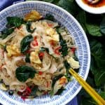 A plate of egg fried rice noodles