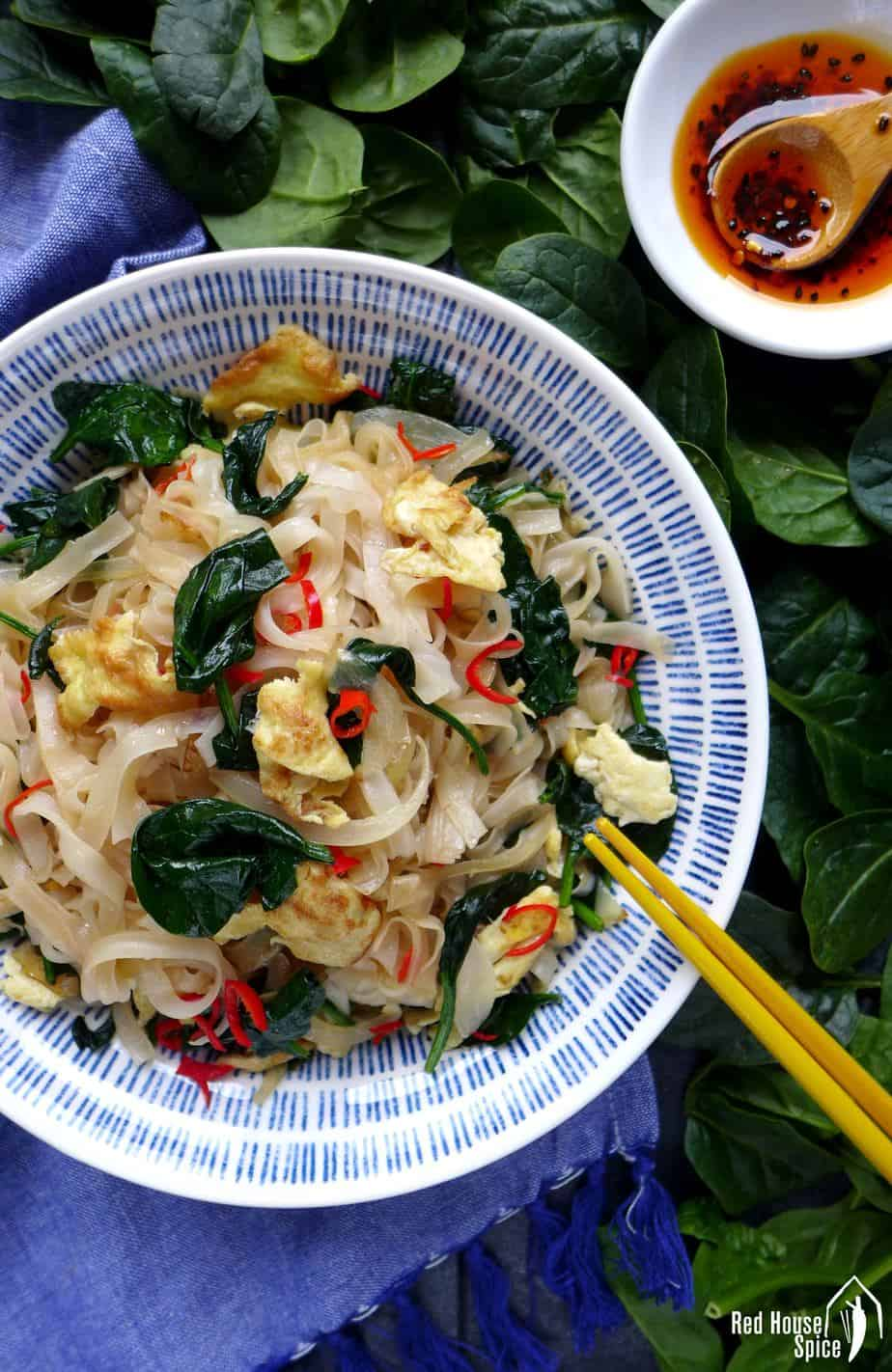 A plate of egg fried rice noodles.