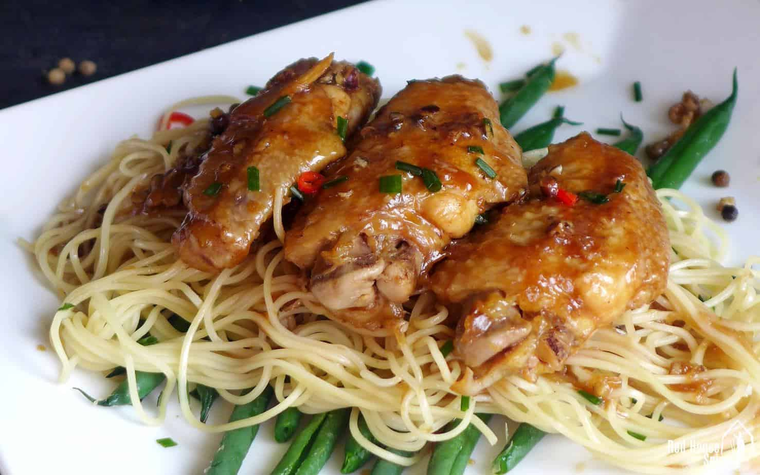 Chicken wings on noodles