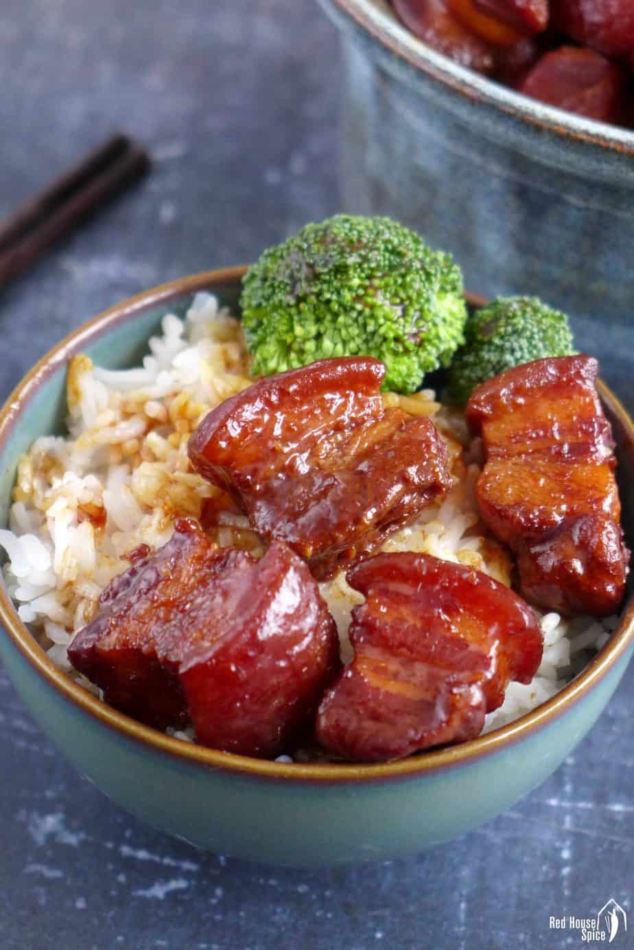 Red braised pork belly over a bowl of rice