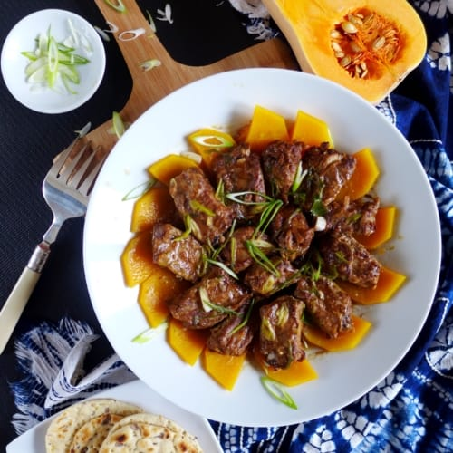 """Seasoned with """"soy cheese"""", these steamed pork ribs leave a unique aroma in your mouth. Butternut squash underneath collects all the flavour from the meat."""