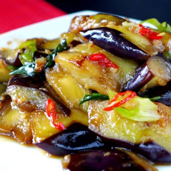a plate of stir-fried eggplant with plum sauce