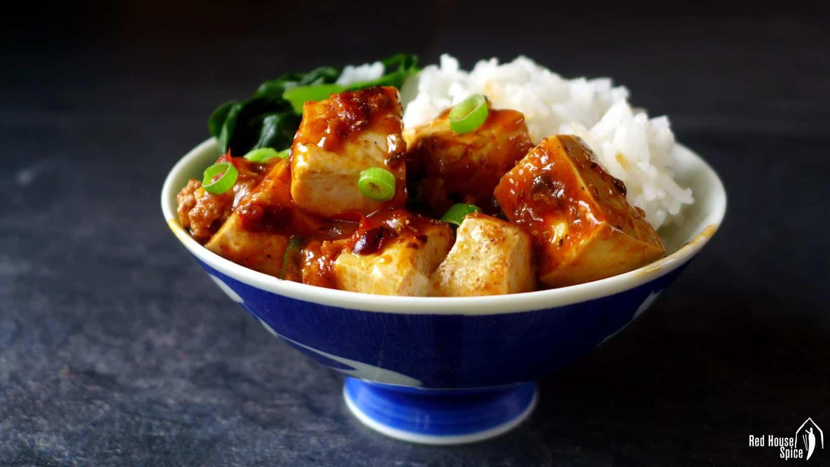 Mapo tofu over a bowl of plain rice
