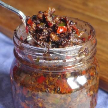A jar of spicy black bean sauce.