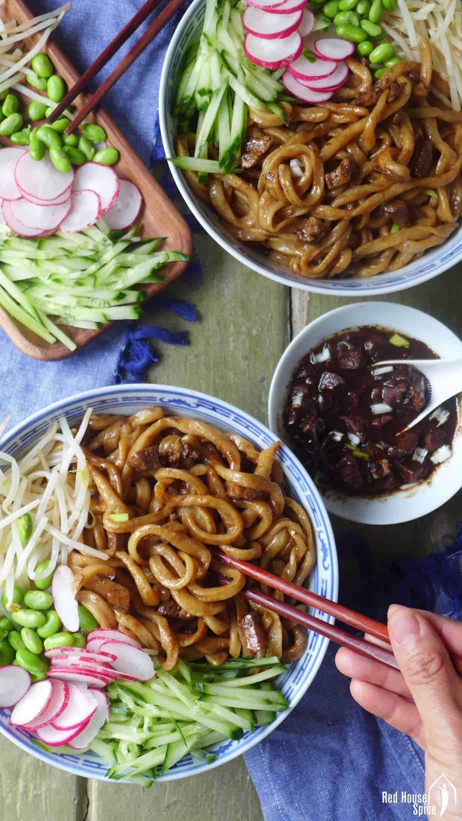 Pork cubes cooked in a salty, fragrant sauce, then served with noodles and various vegetables, Zha Jiang Mian is a signature Beijing dish full of flavour and freshness.