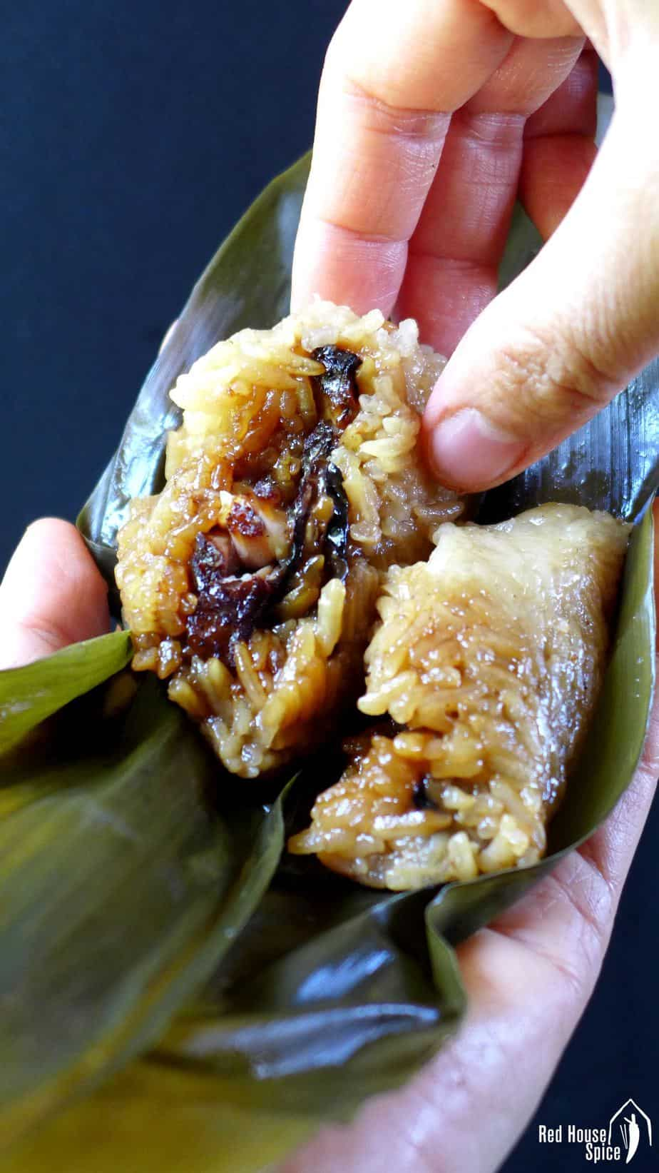 A unwrapped sticky rice dumpling filled with pork & mushrooms