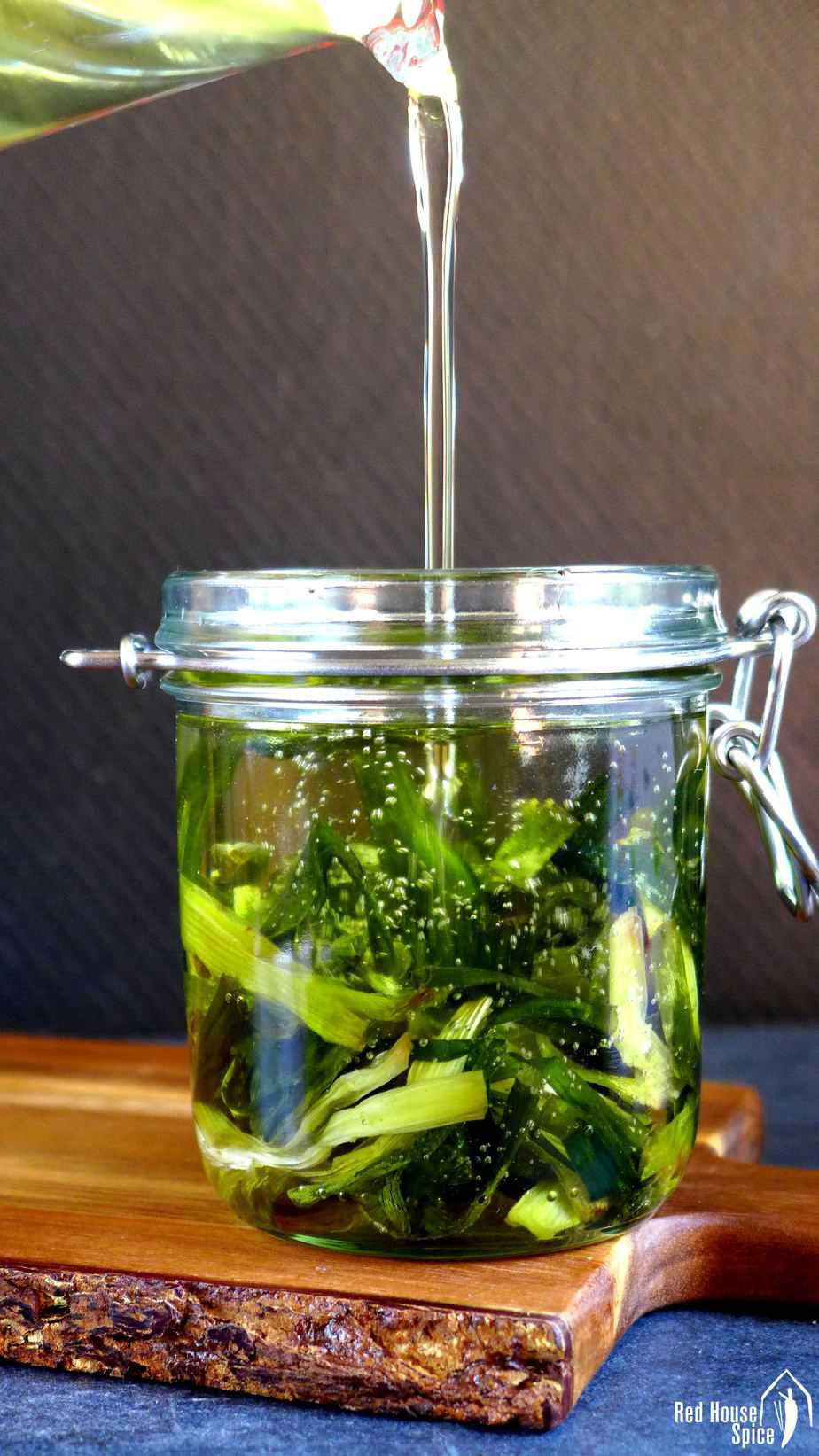 Spring onion oil pouring into a jar