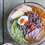 a bowl of cold soba noodle soup