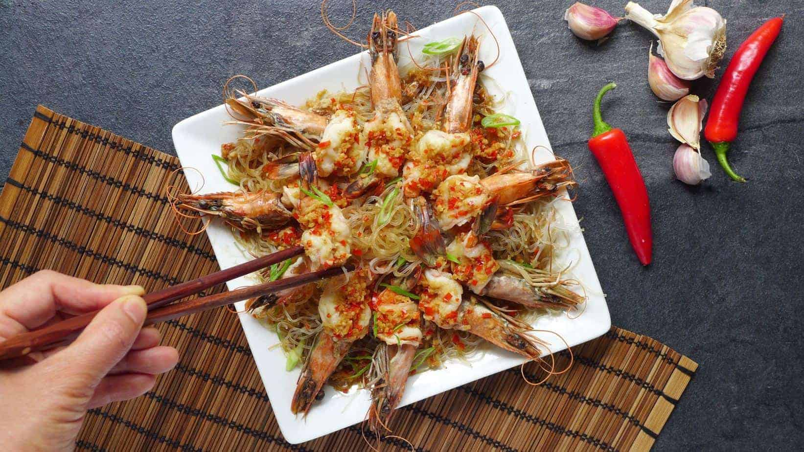 A plate of steamed prawns and mung bean noodles
