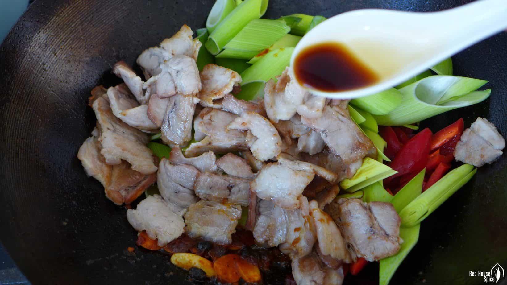 pork and leek in a wok