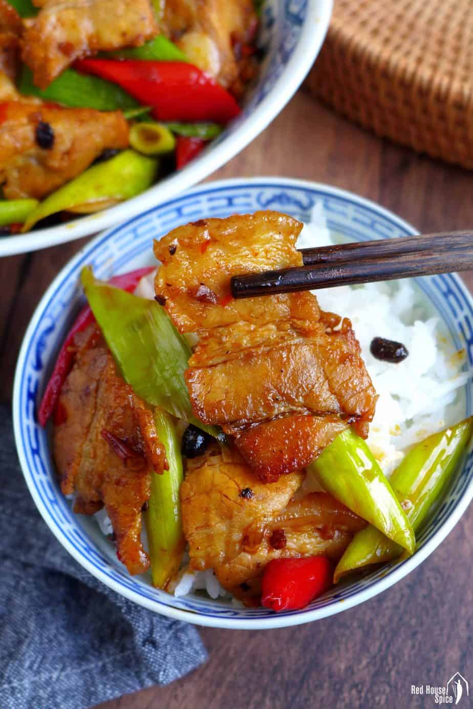 Chinese twice cooked pork over a bowl of rice