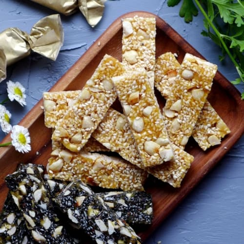 Chinese peanut & sesame brittle on a plate