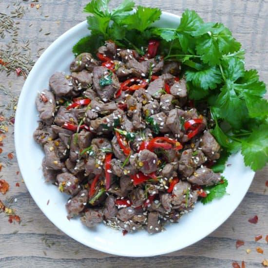 Spicy cumin lamb stir-fry garnished with coriander