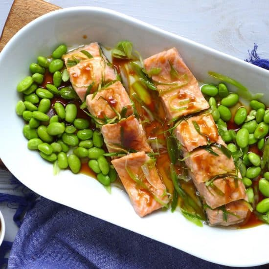 A healthy, tasty dish ready in 10 minutes. Steamed salmon fillets with homemade spring onion oil is aromatic, moist and tender.