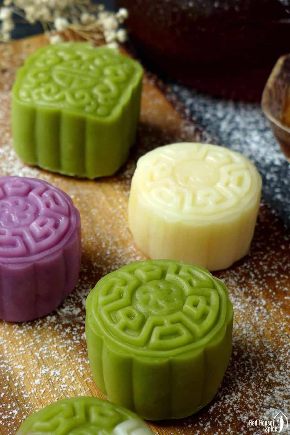 Snow skin mooncakes make in white, green and purple colour