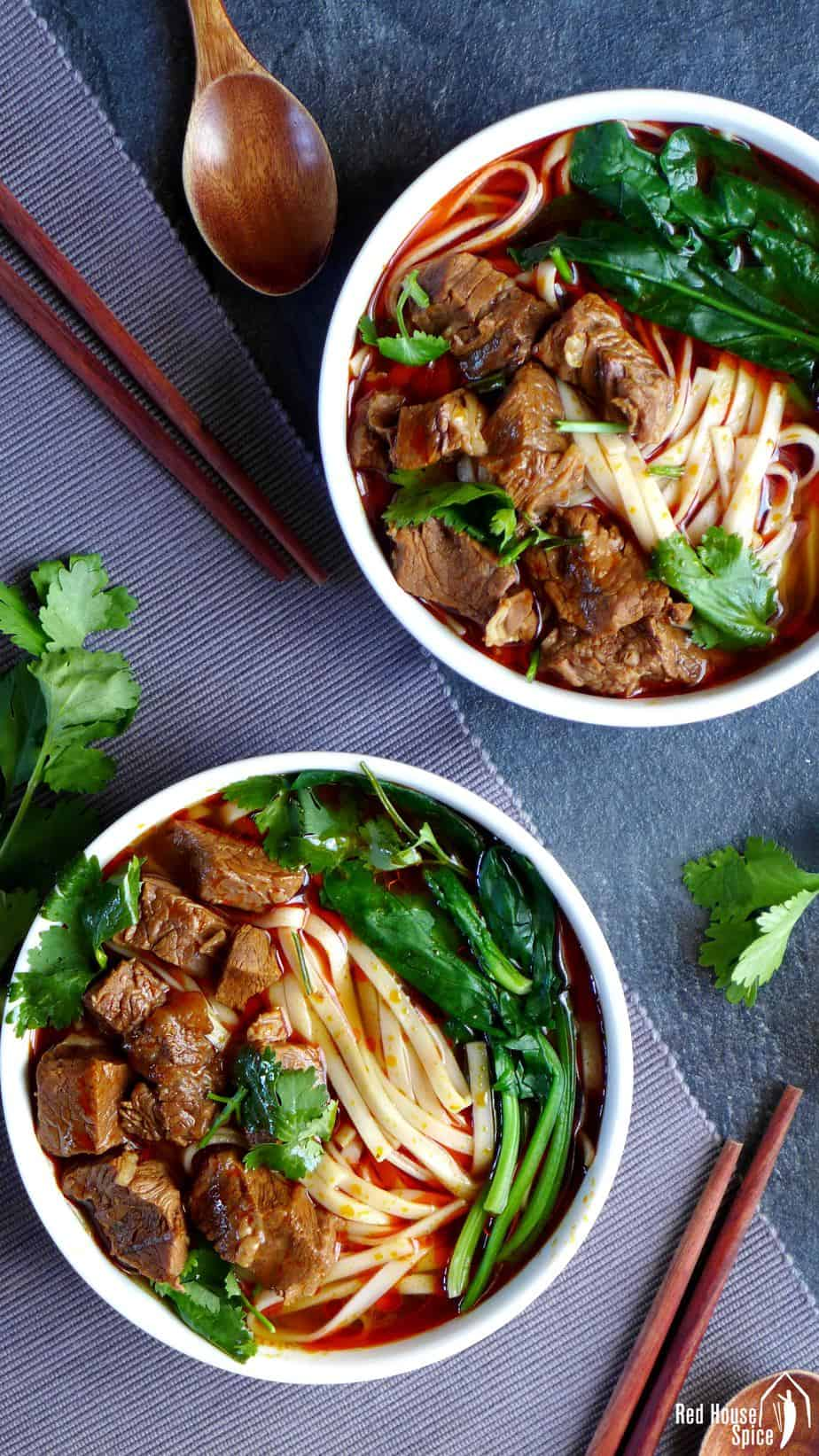 Two bowls of Sichuan style beef noodle soup