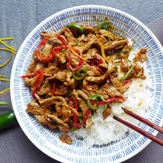 Spicy orange beef stir fry on top of some plain rice.