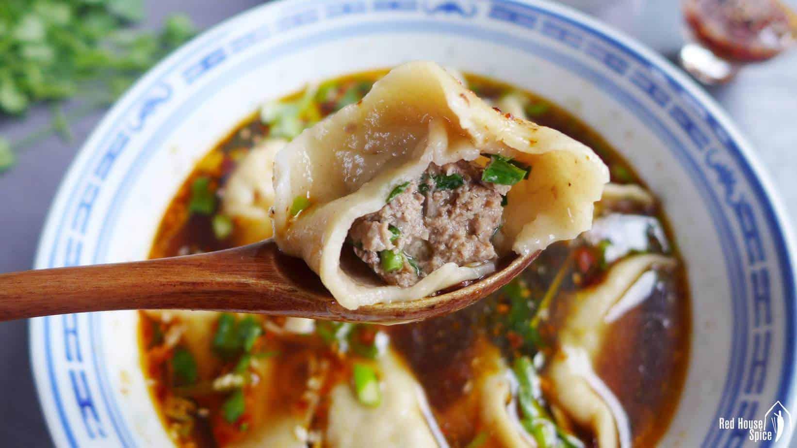 A half eaten beef dumpling.
