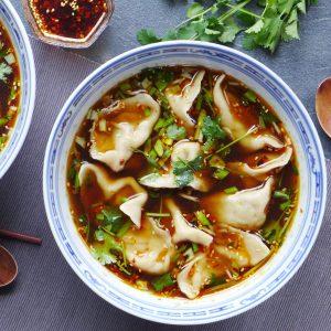 A bowl of beef dumplings in a hot & sour soup.