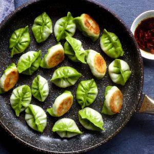 Pan fried dumplings that resemble Pak Choi.