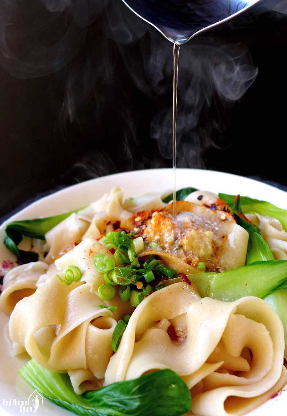 Hot oil pouring over Biang Biang noodles