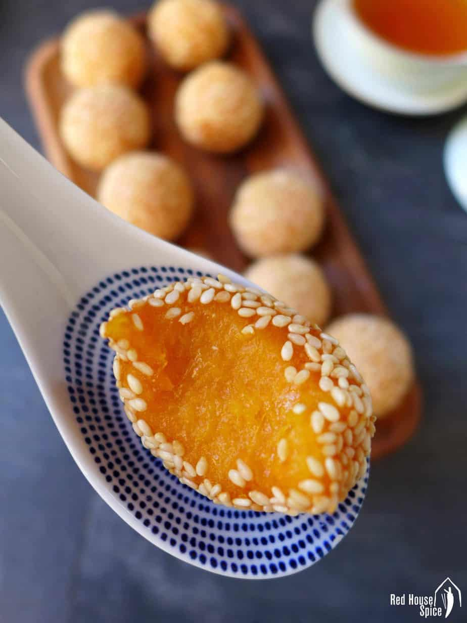 A half-eaten sweet potato sesame ball