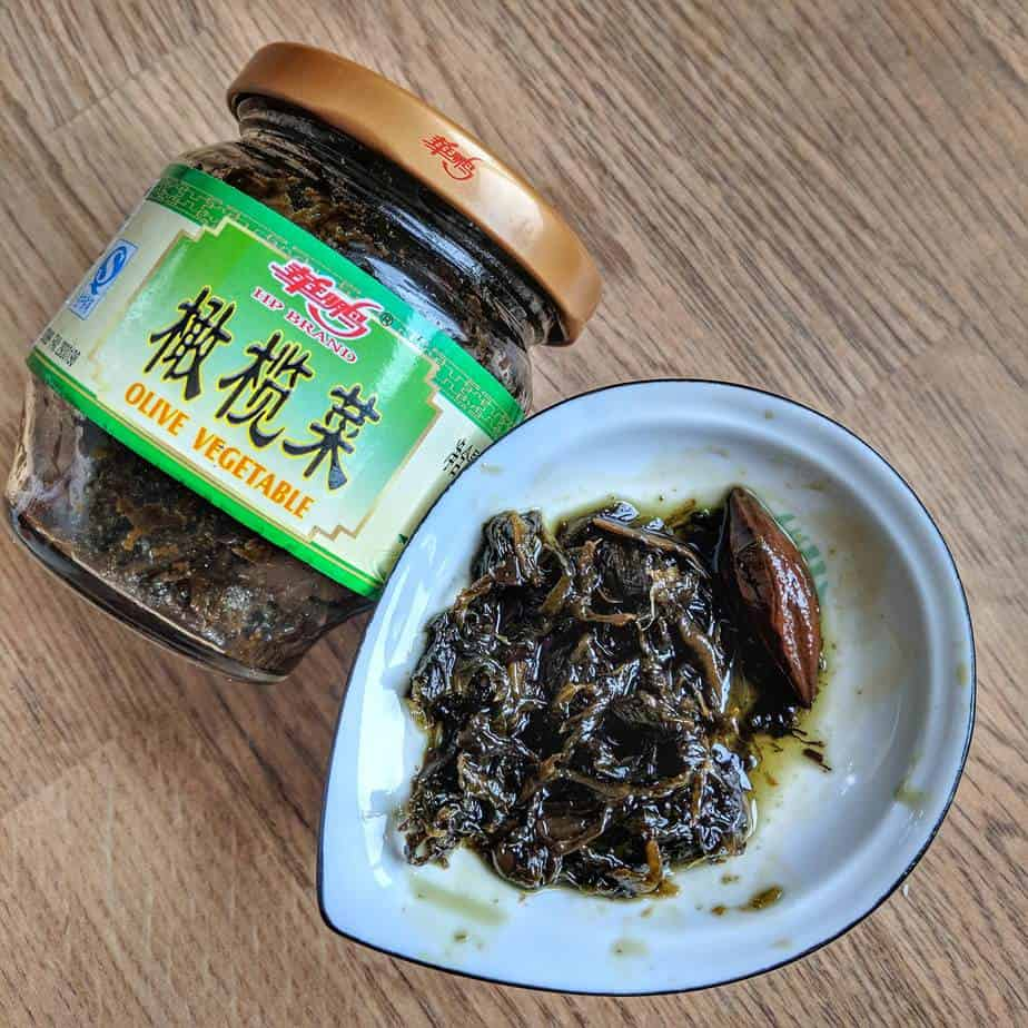Chinese olive vegetable is a dark green paste-like mixture of mustard green and Chinese olive fruit. It usually comes in jars.
