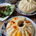 A fluffy steamed bao bun dressed with chilli oil. Looks very appetizing.