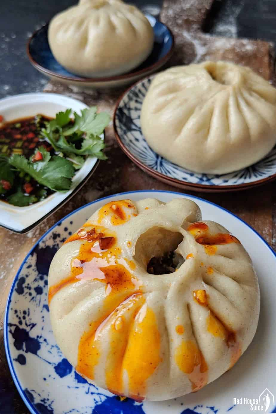 Steamed bao bun dressed with chilli oil.