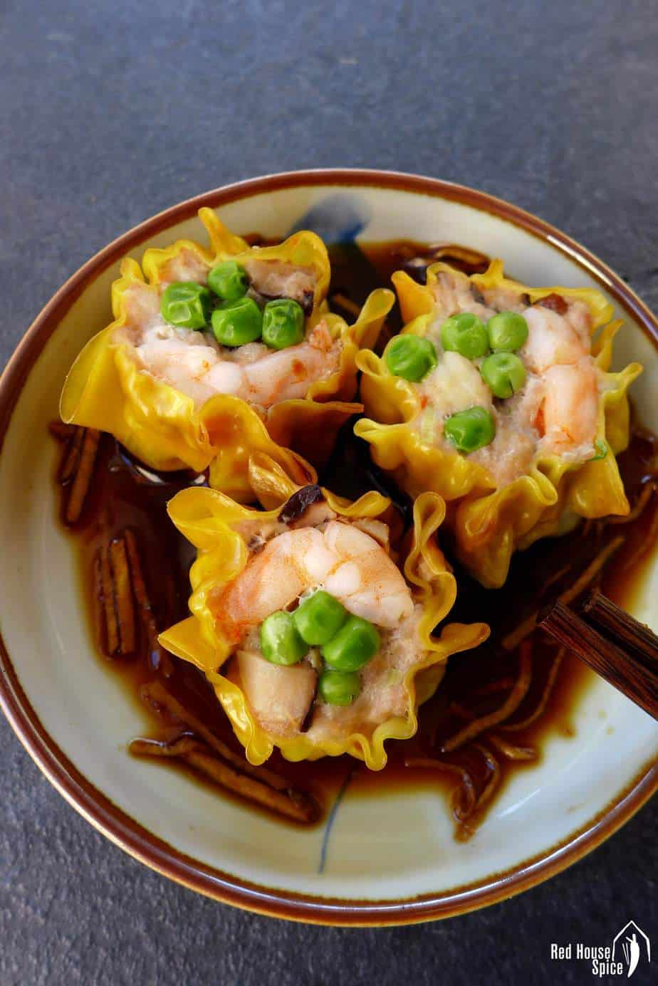 One of the most popular Cantonese dim sum dishes, shrimp & pork shumai is delicate, tasty and very easy to make in your own kitchen.