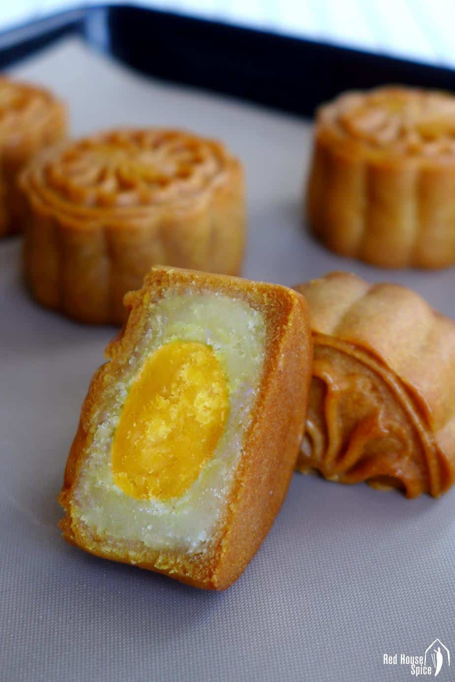 A halved mooncake showing the salted egg yolk filling