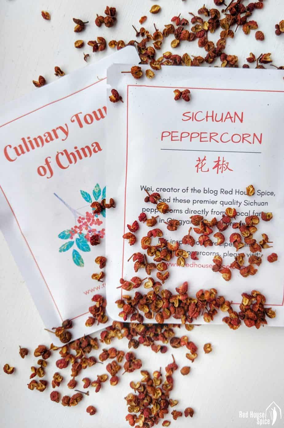 Two sachets and some loose Sichuan pepper