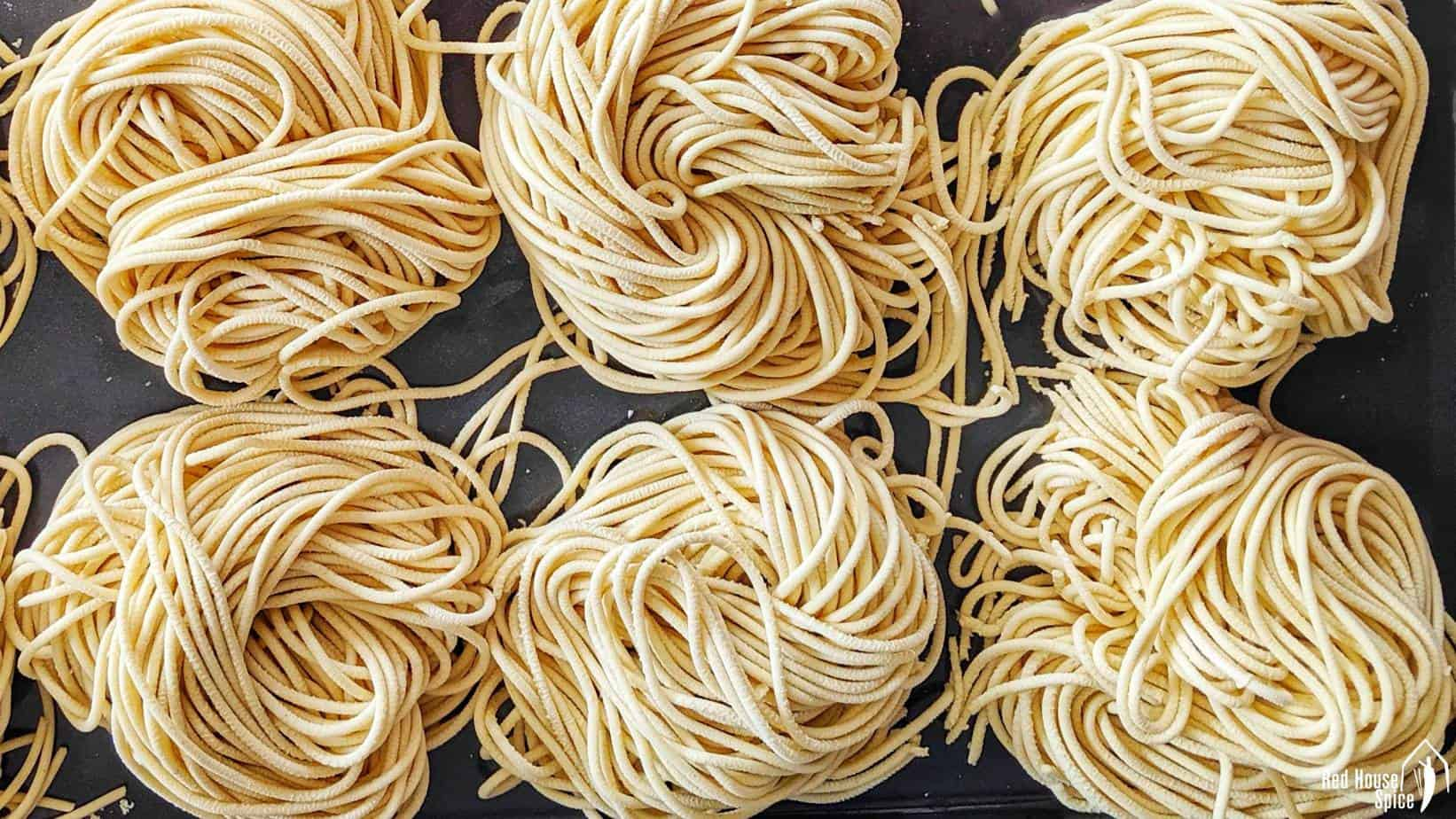 Six rolls of fresh alkaline noodles.
