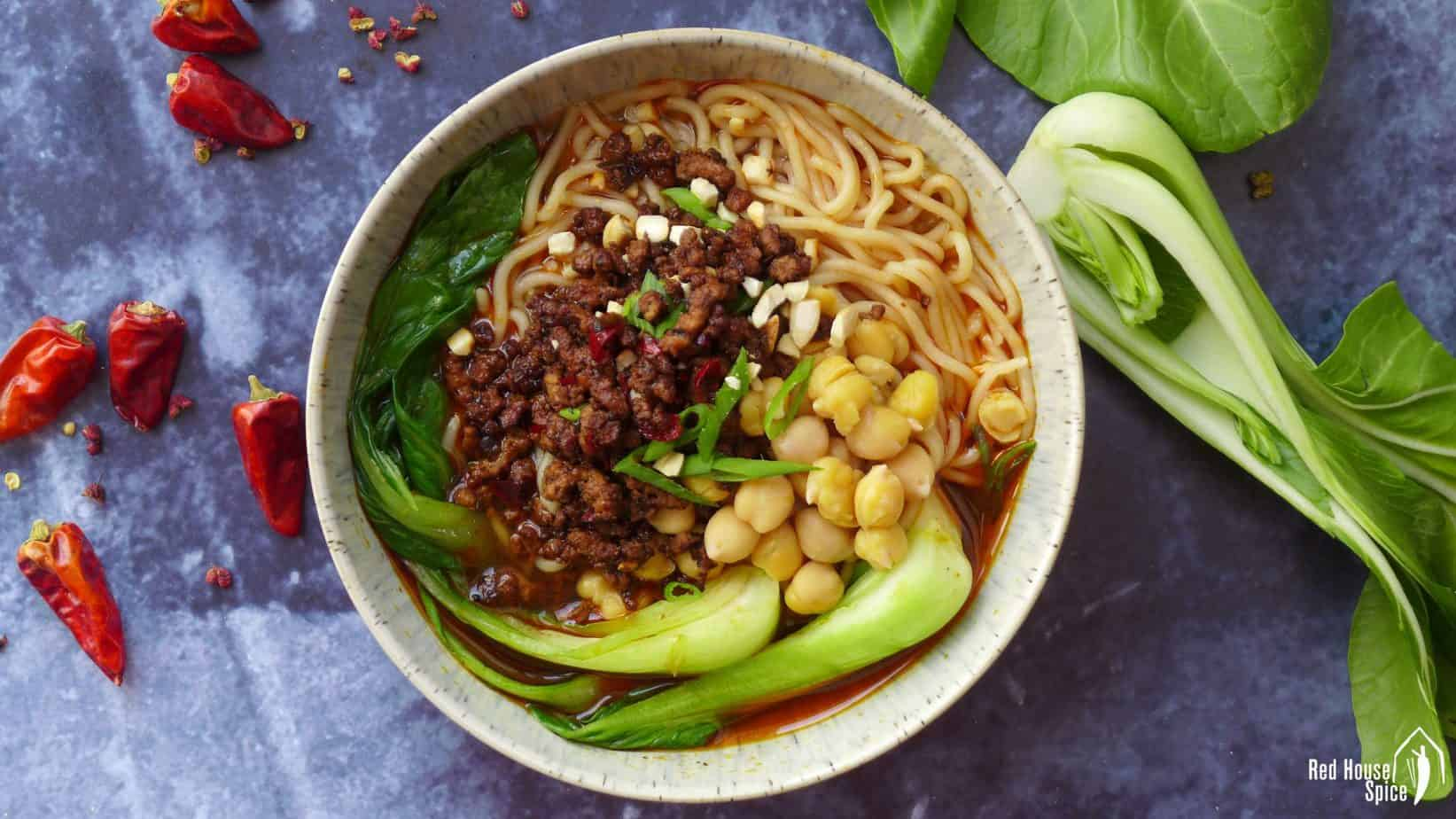 A bowl of Chongqing noodles with minced meat and Bok Choy
