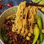 Chongqing noodles lifted up by a pair of chopsticks.