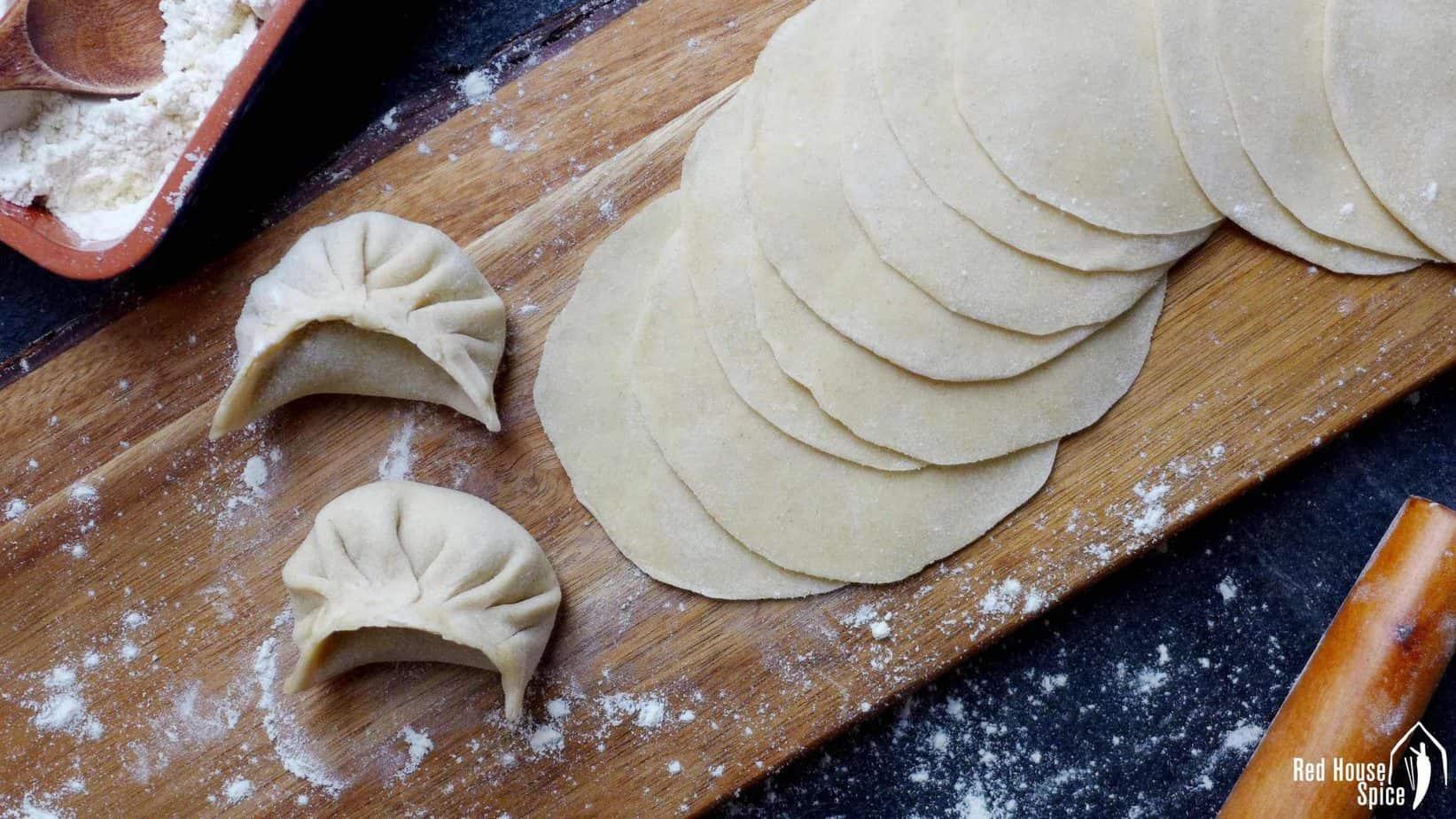 Homemade dumpling wrappers with 2 dumplings.