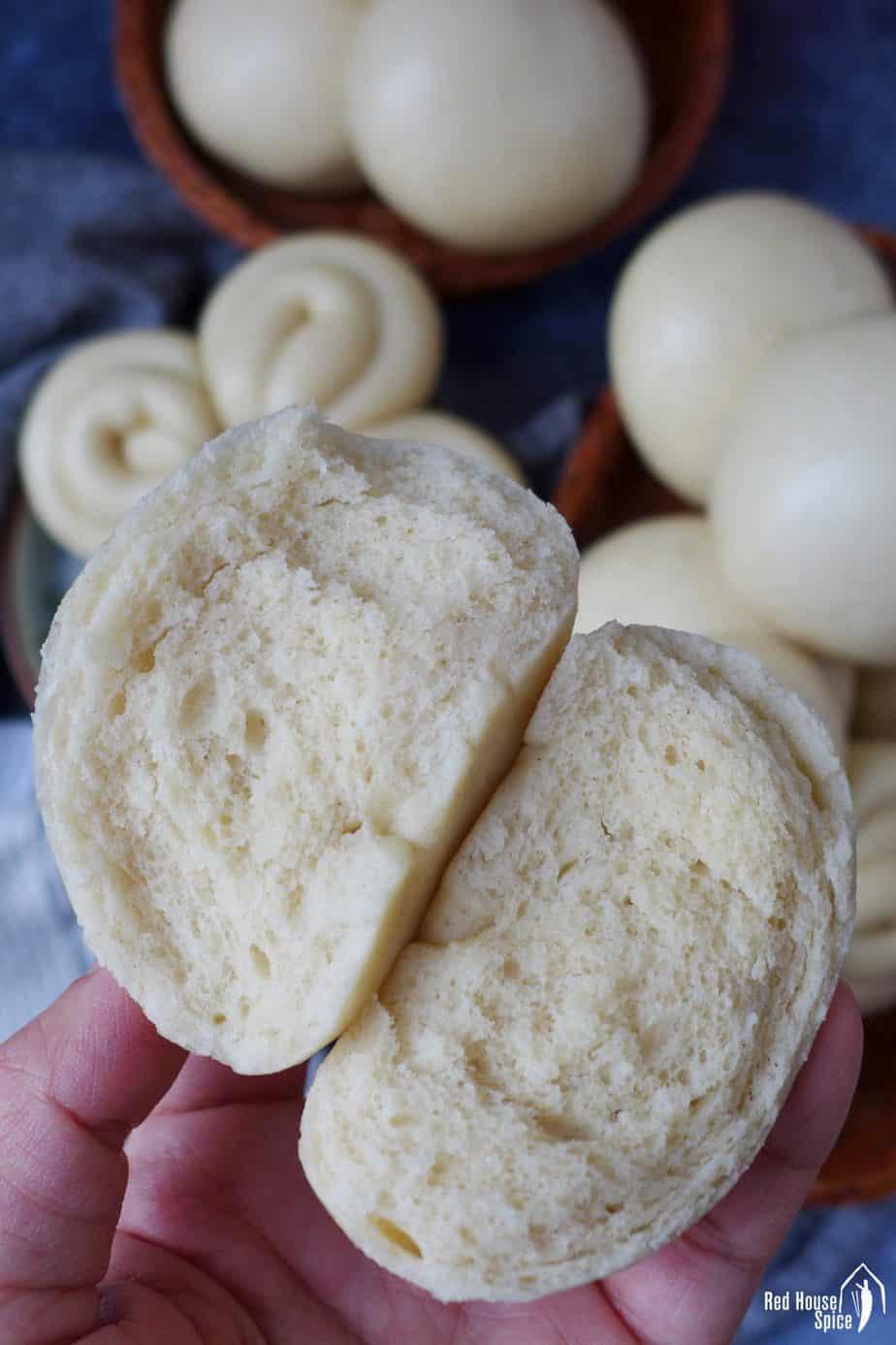 A Chinese steam bun torn into halves.
