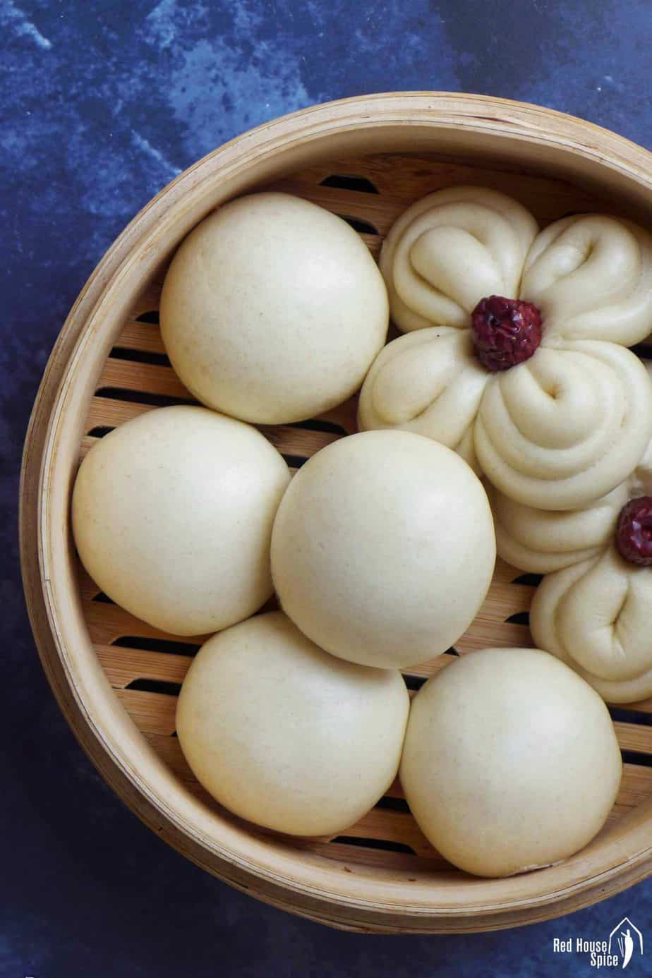 Chinese steamed buns in a bamboo basket.