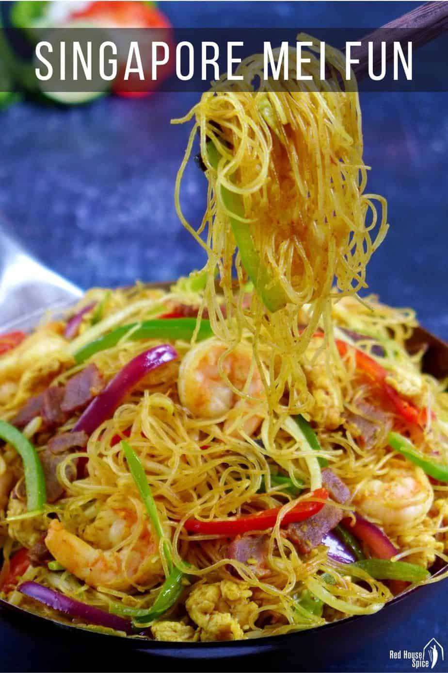 Singapore rice noodles lifted by chopsticks