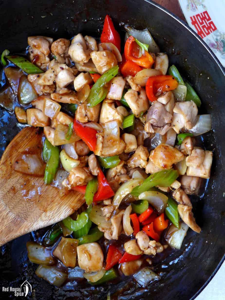 Black pepper chicken in a wok