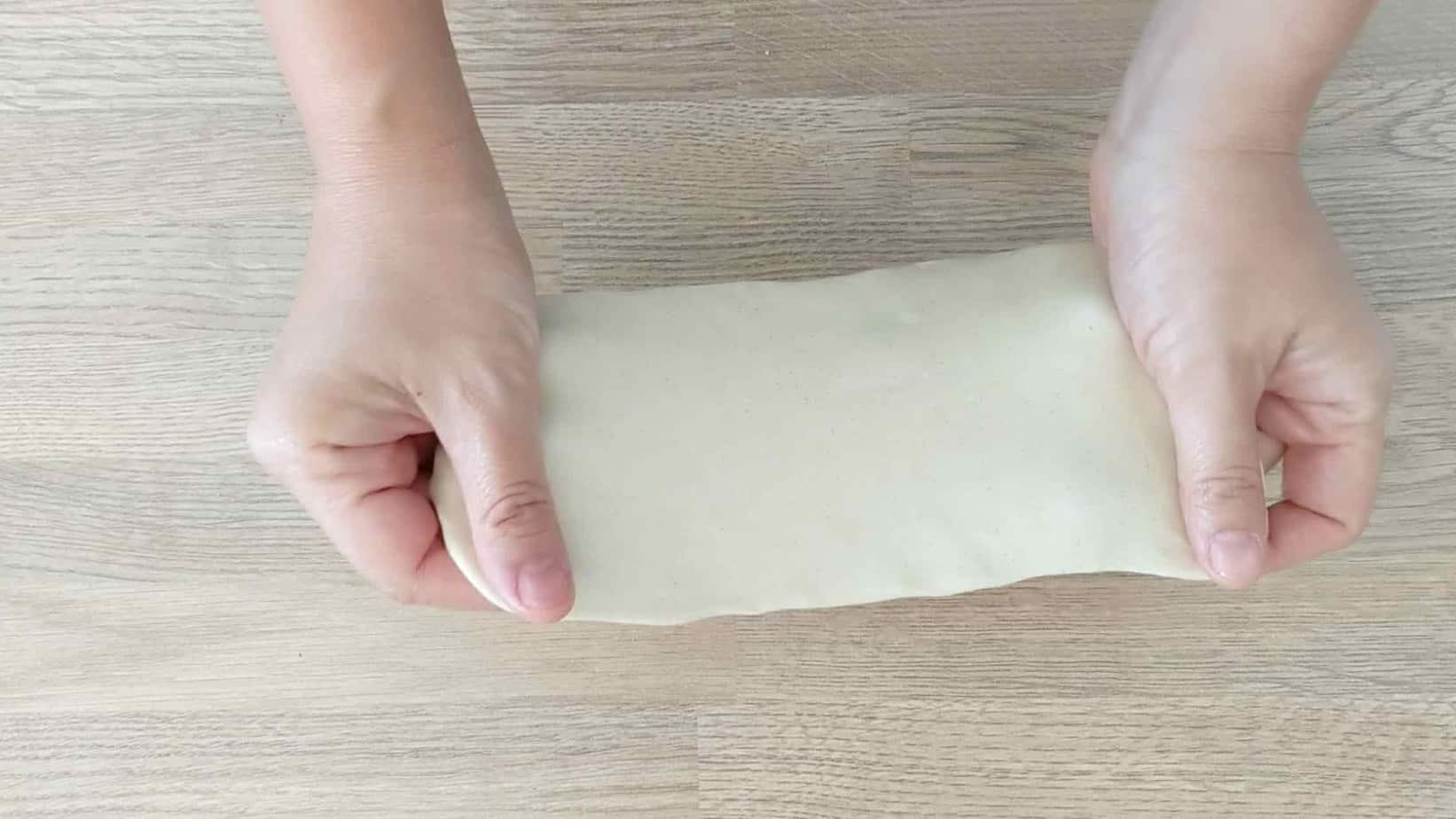 Pulling a dough piece