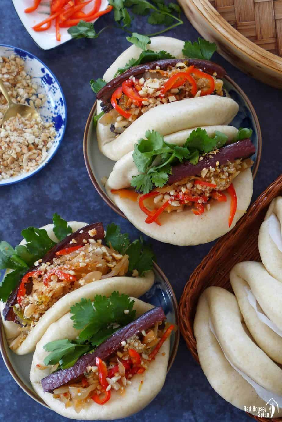 Assembled Gua Bao stuffed with pork belly slices.